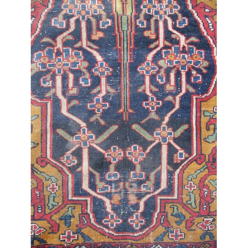 288 - A Persian runner with a tree flanked by flowering vines on a black ground, 48 x 159