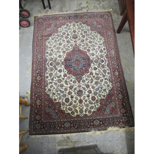 290 - A Central Persian carpet with pelmets, boteh and a central medallion on a cream ground 73 x 108