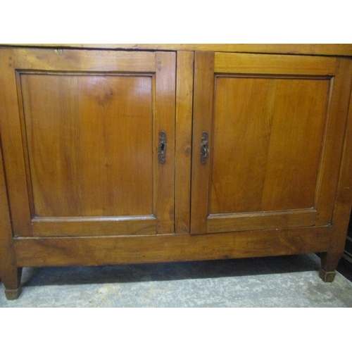 293 - An 18th Century Italian cherry wood cabinet with a frieze drawer, over two panelled doors, on square...