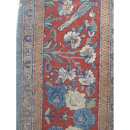 294 - A Central Persian rug with a central medallion, flowers and foliage on a pale blue ground 51