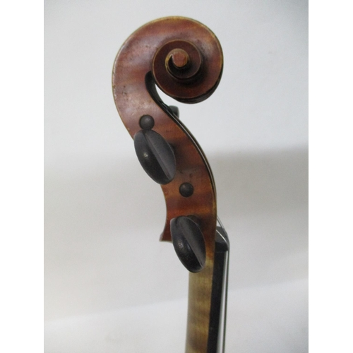 296 - A late 19th century violin with a N Audinot label, 1899 No 695 in pencil with a two piece back and i...