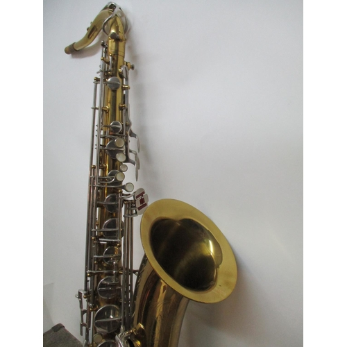 297 - A Buisson MK 1X saxophone with a brass body and silver plated keys, 31