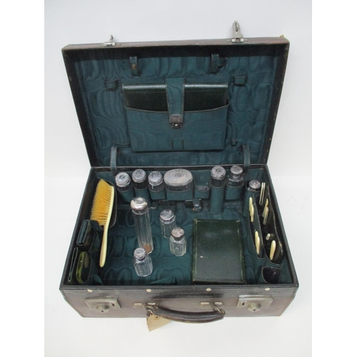 299 - A Victorian brown leather vanity case enclosing a green fabric lined interior, the clasp inscribed D...