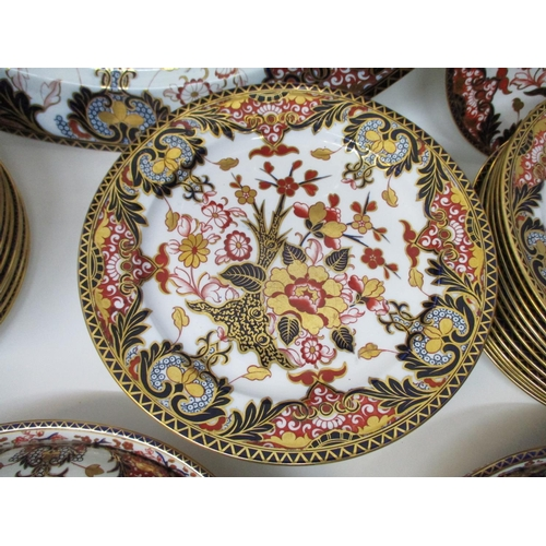 301 - A Derby Japan pattern part dinner service decorated in the Imari palette with a tree and flowers on ...