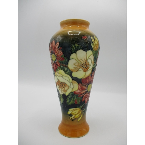 303 - A Moorcroft, Emma Bossons decorated, MCC collectors vase decorated with flowers in yellow, red, gree...