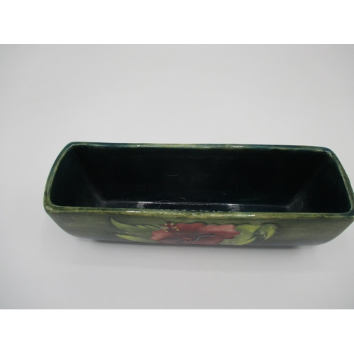 311 - A Moorcroft hibiscus pattern elongated trough decorated in purple, green and yellow, impressed Made ...
