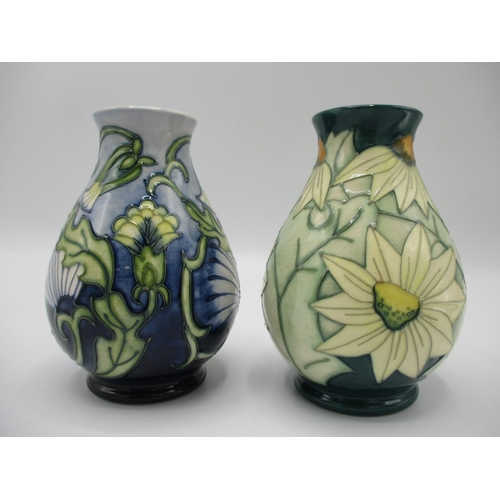 312 - A Moorcroft summer lawn pattern vase of baluster form, decorated in cream, green, and another vase i...