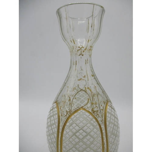 241 - A 19th century Bohemian white overlaid, cut and gilded glass vase, decorated with six leaf shaped ho...