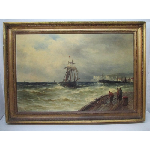266 - Gustave de Breanski - a harbour scene with a boat coming into moor and white cliffs beyond, oil on c...