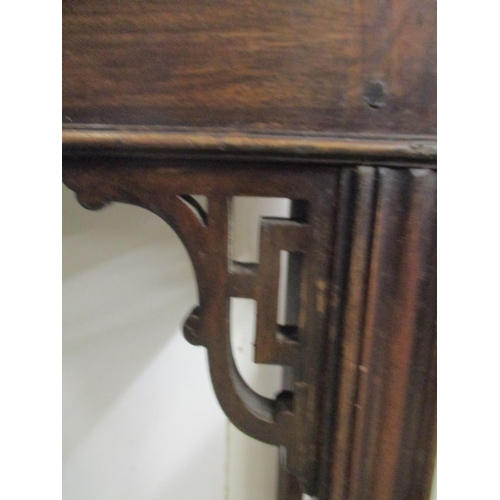 324 - A George III Chippendale style mahogany tea/card table with a double foldover top, on square moulded...