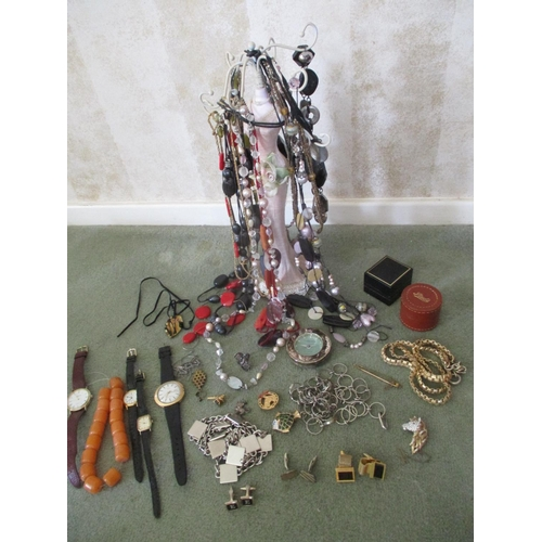 21 - A selection of miscellaneous costume jewellery to include mixed necklaces, and wrist watches, amber ...