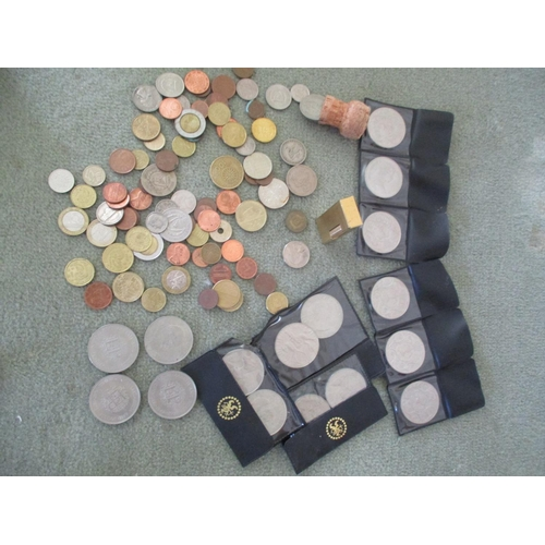 23 - A quantity of coins to include Churchill crowns, together with a gold coloured Dunhill lighter Locat...