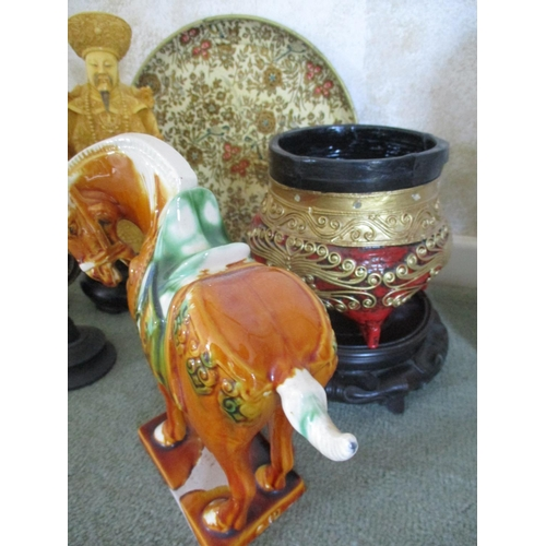 28 - Oriental and Eastern inspired ceramics and ornaments to include a dog of foe, a papermache tray, a T...