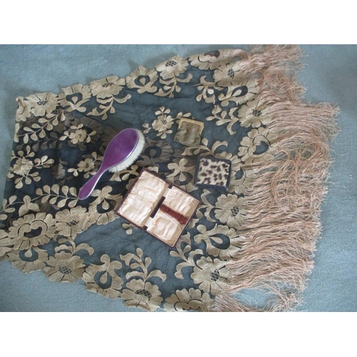 3 - A silver and lilac enamelled hair brush, a gold coloured vintage chain purse, a leather and fur vint...