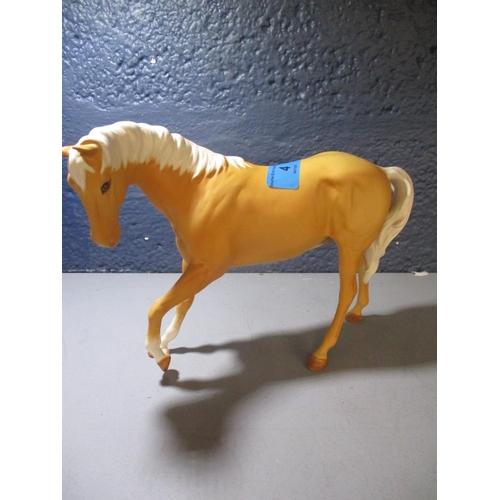 4 - A Beswick figure of a Palomino horse Location: 2:3...