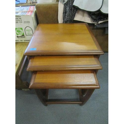 66 - A next of three teak Griffin tables Location: RWB...