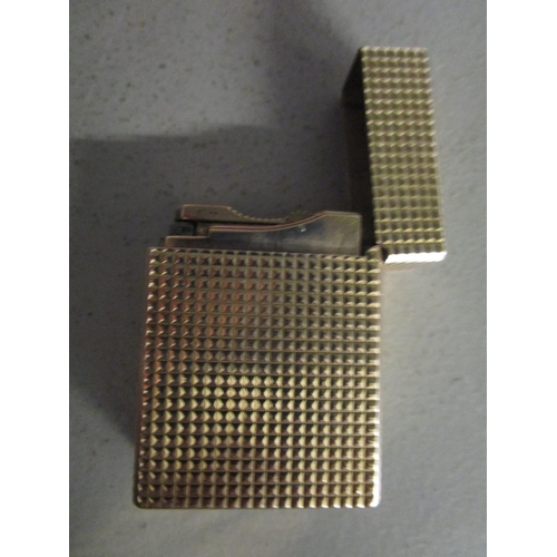 77 - A gold plate DuPont lighters with engine turned decoration Location: CAB...