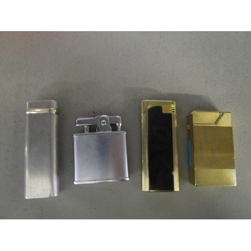78 - A gold plate Dunhill lighter, a Cartier lighter and Ronson and another lighter Location: CAB...