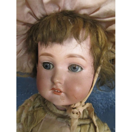 79 - A late Victorian/Edwardian German bisque headed doll with sleeping grey eyes, composition jointed bo...