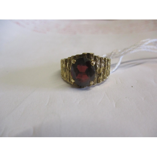 8 - A 9ct and garnet ring, 5.67g Location: CAB...