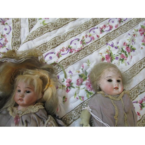 80 - An Armand Marseilles bisque headed doll with fixed brown eyes and three teeth showing, bisque hands ...