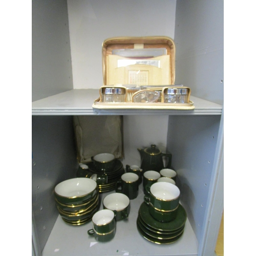 82 - An Apilco French green glazed porcelain part breakfast set and a real leather mid century vanity set...