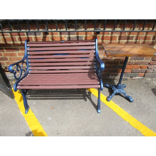 85 - A modern blue painted cast iron garden bench 40