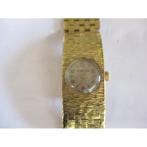 9 - A 9ct gold ladies Rubis dress watch, total weight 29.25g Location: CAB...