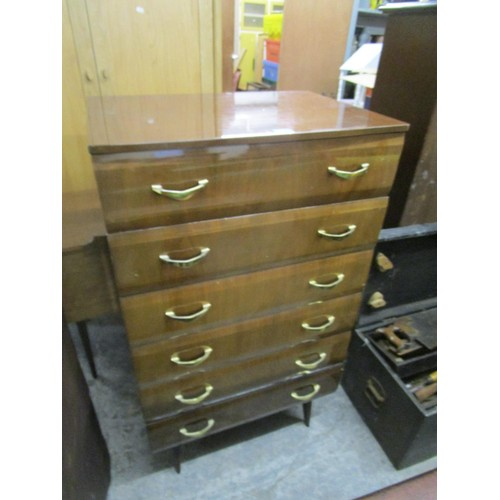 84 - A mid 20th century walnut finished six drawer chest and a matching dressing table Location: G...