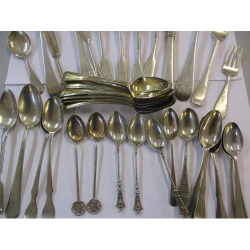 14 - A quantity of silver and white metal flatware, mainly spoons to include a Georgian table spoon and e...