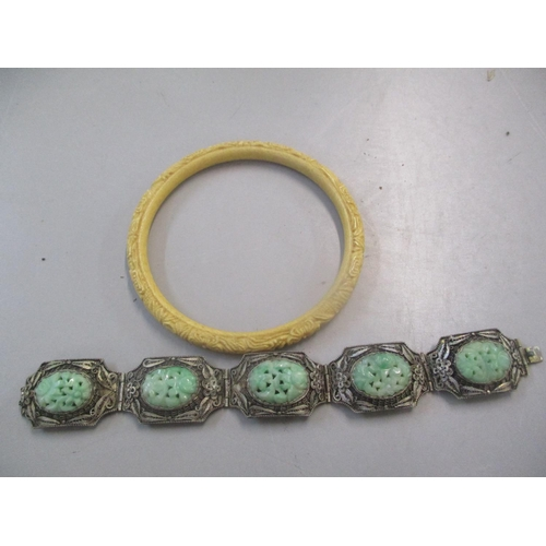 19 - A Chinese white metal jade inset bracelet, together with an ivory bangle Location: CAB...