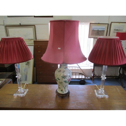 31 - A pair of clear Perspex table lamps and a late 20th century oriental style ceramic lamp on treen mou...