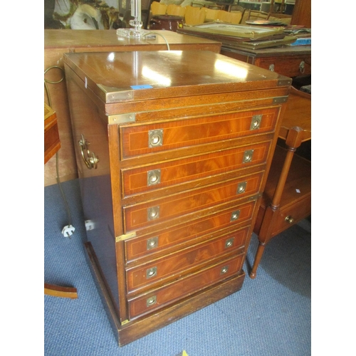 32 - A reproduction campaign style low side drawer chest having a swivel fold over top with green leather...
