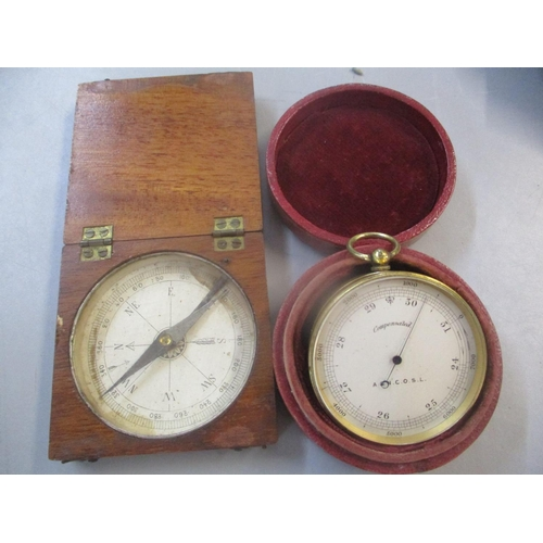 38 - A pocket barometer in a leather case, having a silvered dial inscribed 'Compensated, A & N.C.O.S.L' ...