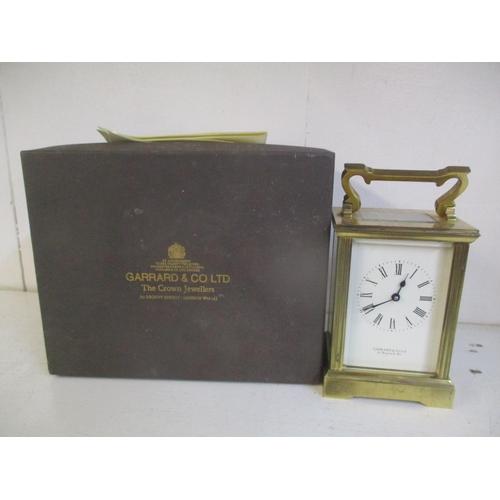 39 - A Garrard & Co. brass cased carriage clock with original box, keys and guarantee Location: RWM...