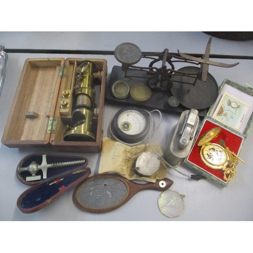 42 - A mixed lot to include a small set of scales, gilt pocket watch, table lighter and other items Locat...