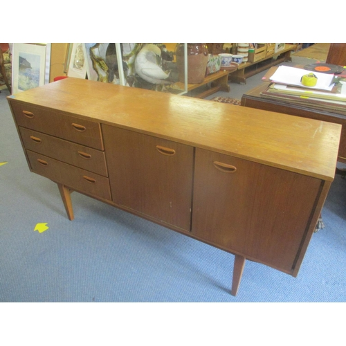 56 - A mid 20th century retro teak sideboard having three drawers and two cupboard doors 30.5