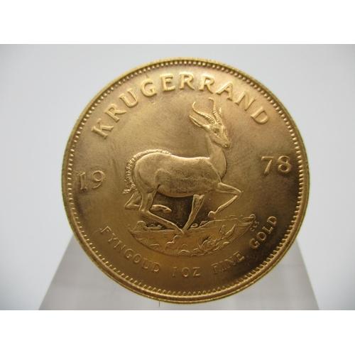 244 - A Gold Krugerrand inscribed Fyngoud 1oz fine gold 1978...