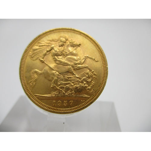 262 - An Elizabeth II gold full sovereign with St George to the obverse 1957...