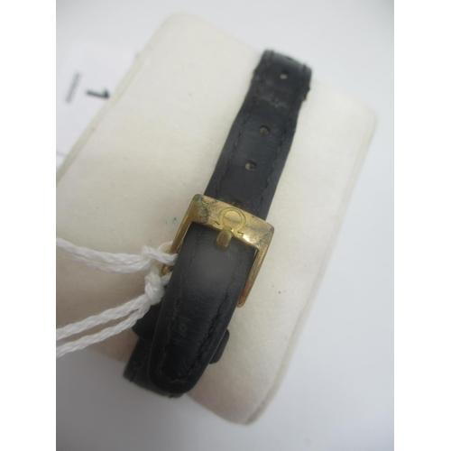 1 - A modern Omega De Ville ladies, steel and gold quartz wristwatch having a white dial with gilt Roman...