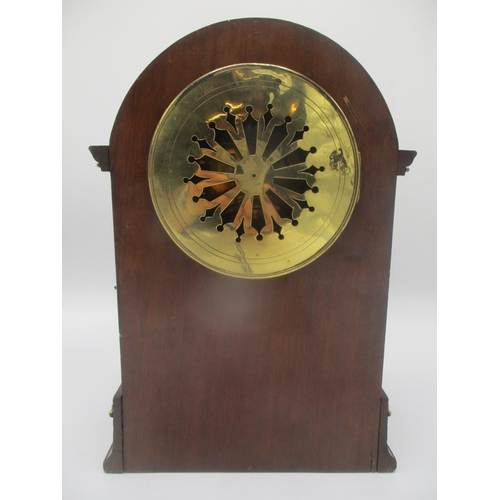 10 - A late 19th century mahogany 8 day, arched top mantle clock having a white enamel dial with Arabic n...