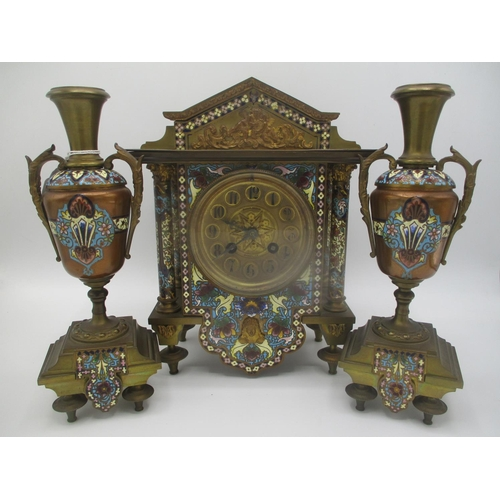 14 - A late 19th century gilt metal cloisonne clock garniture set, the clock of architectural form having...