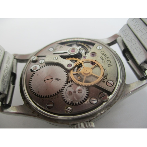 15 - A WW2 Omega manual wind gents stainless steel wristwatch, circa 1943, possibly military. The dial ha...