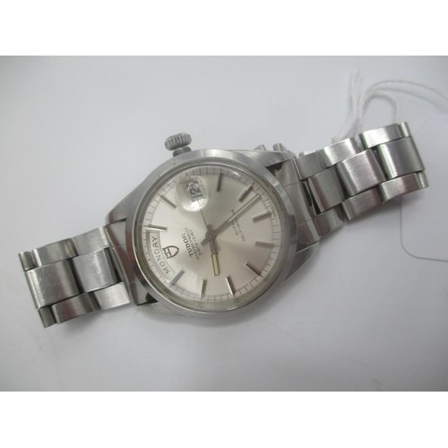 16 - A Tudor Oyster Prince Day Date automatic gents, stainless steel wristwatch having a silvered dial wi...