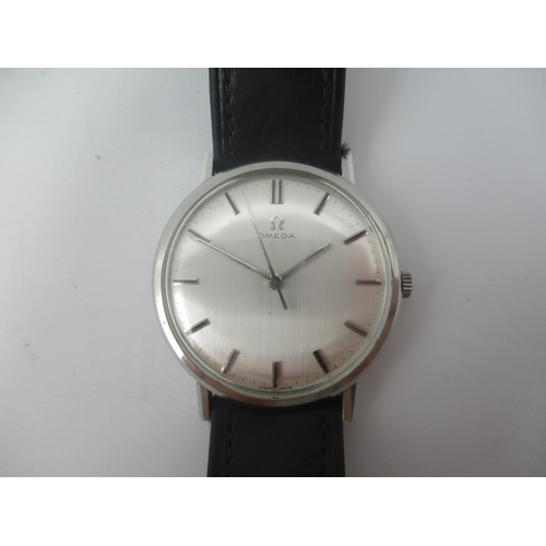 17 - An Omega manual wind, gents stainless steel 1960s wristwatch having a silvered dial with centre seco...