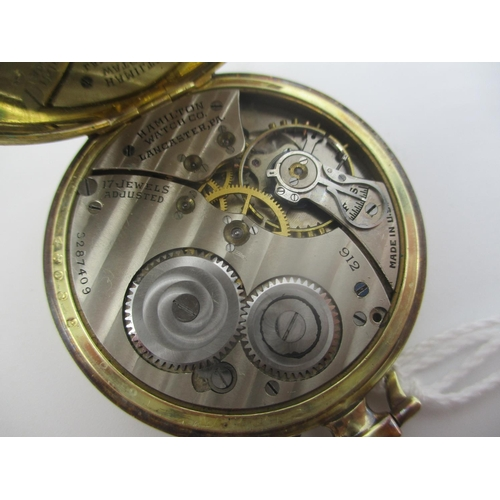 2 - An early 20th century Hamilton 14k gold filled, open faced pocket watch having a silvered dial with ...