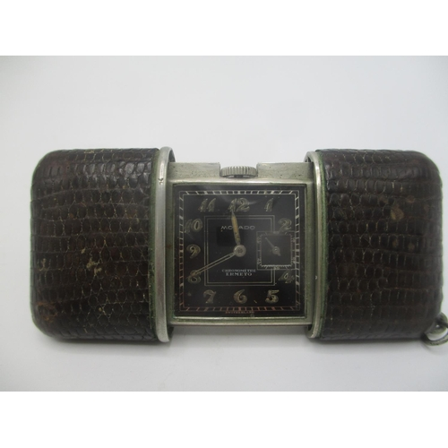 20 - An Art Deco Movado Ermeto chronometer manual wind purse watch having a black dial with subsidary sec...