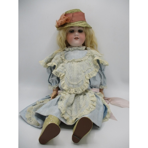 214 - An Armand Marseille German bisque headed doll, 390 with closing eyes, open mouth and jointed limbs, ...