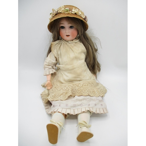 215 - An early 20th century German bisque headed doll stamped A.75 with closing eyes, open mouth and joint...