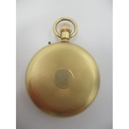 22 - A late 19th/early 20th century 18ct gold open faced, keyless wound fob watch having a machine turned...